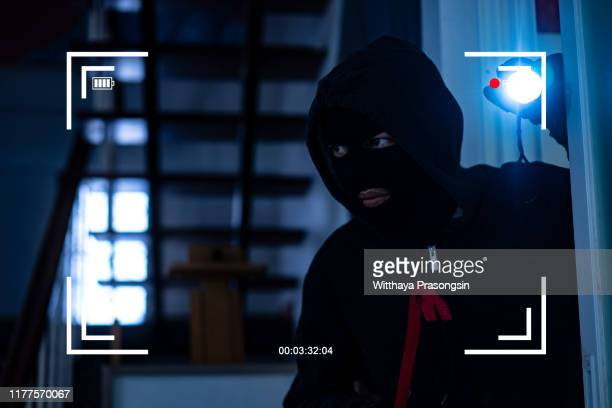 cctv view of burglar breaking in to home - burglar stock pictures, royalty-free photos & images