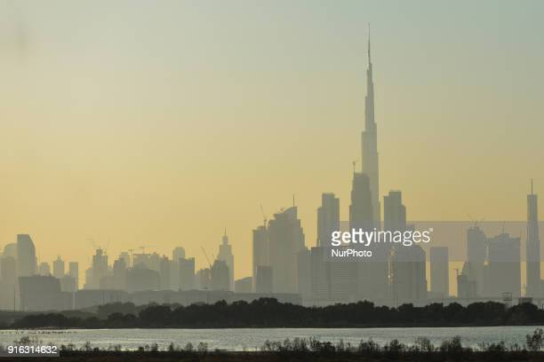 A view of Burj Khalifa and Dubai center covered by fog and pollution during a winter sunset On Friday February 9 in Dubai United Arab Emirates