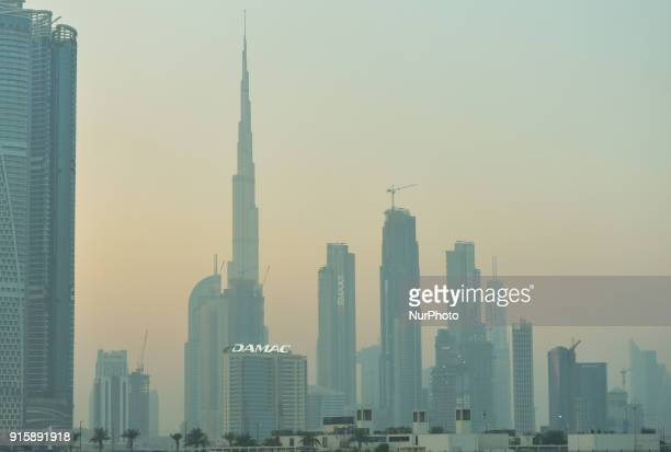 A view of Burj Khalifa and Dubai center covered by fog during a winter sunset On Thursday February 8 in Dubai United Arab Emirates