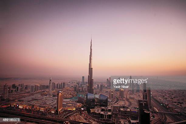 CONTENT] A view of Burj Khalifah and skyline at sunset
