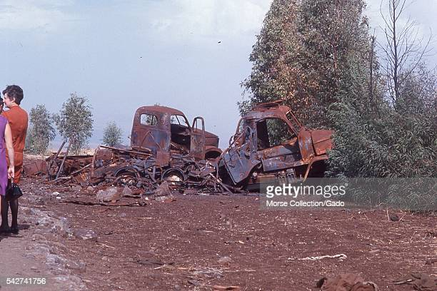 View of burned and rusted remains of military vehicles used in the Six Day War in the Golan Heights outside the town of Quneitra Syria along the...