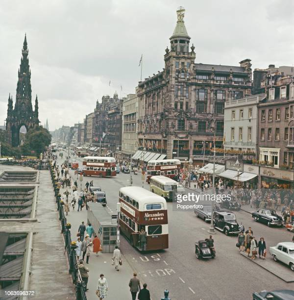 View of buses, cars and pedestrians making their way along Princes Street in Edinburgh, Scotland during the Edinburgh Festival in 1960.