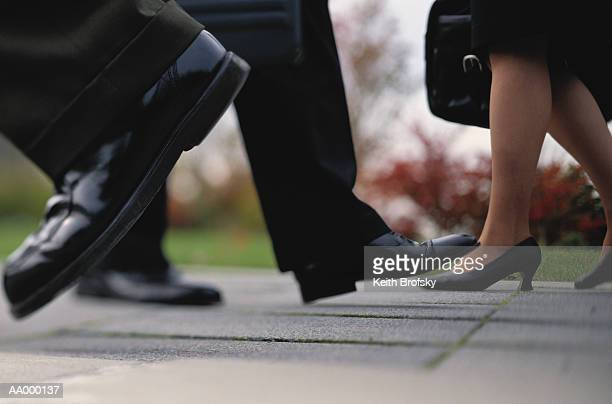 View of Businesspeople's Shoes on the Sidewalk