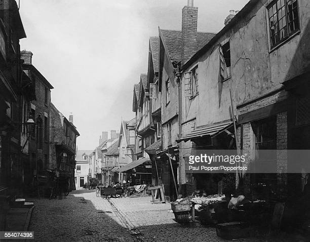 A view of Butcher Row Coventry Warwickshire circa 1875 The street was demolished in 1936 Albumen print by George Washington Wilson