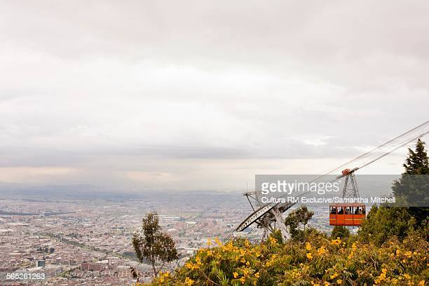 View of cable car on Monserrate mountain and distant Bogota cityscape, Colombia, South America