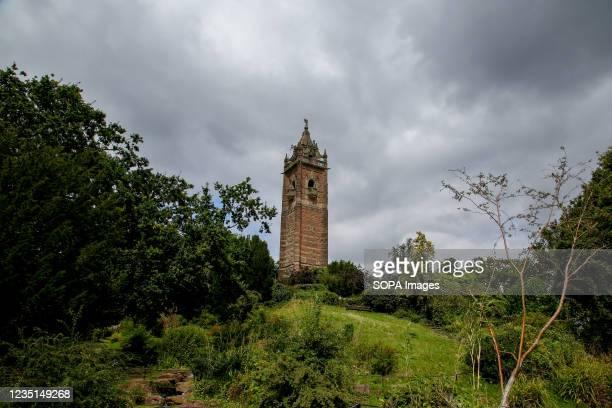 View of Cabot Tower on Brandon Hill under dark rain clouds.
