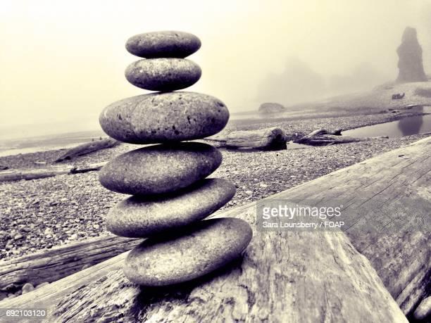 view of cairn on rock stacking - sara stone fotografías e imágenes de stock