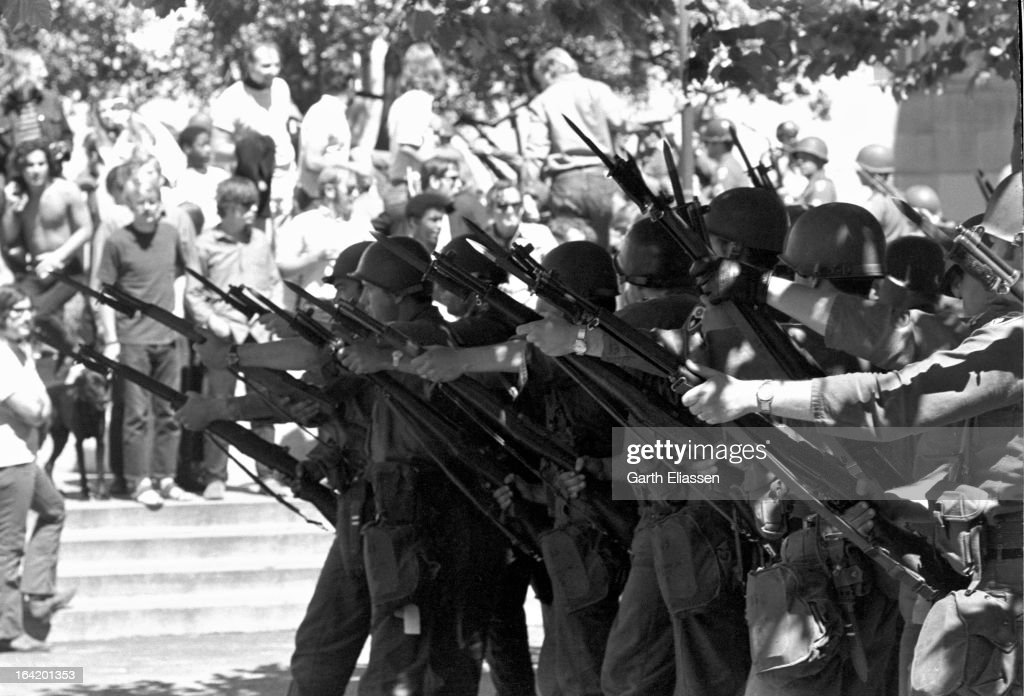 View of California National Guardsmen, bayonets at the ready, during protests near People's Park on the campus of the University of Berkeley, Berkeley, California, May 19, 1969. Protests began initially in respose the University's clearing of a site previously abandoned and reclaimed as a commuity area, and became more pronounced following the May 15th killing, by police, of an unarmed spectator.