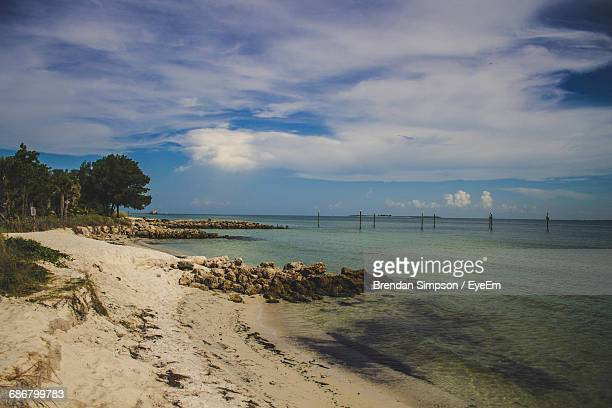 view of calm beach against the sky - anna maria island stock pictures, royalty-free photos & images