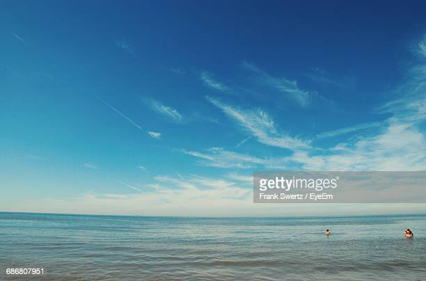 view of calm blue sea against sky - frank swertz stock-fotos und bilder