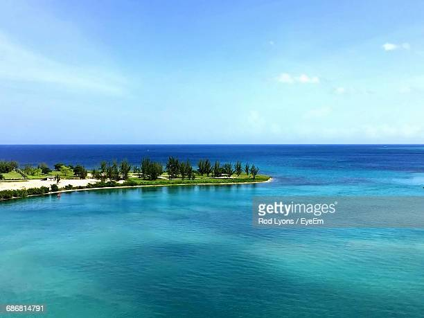 view of calm blue sea against the sky - montego bay stock pictures, royalty-free photos & images