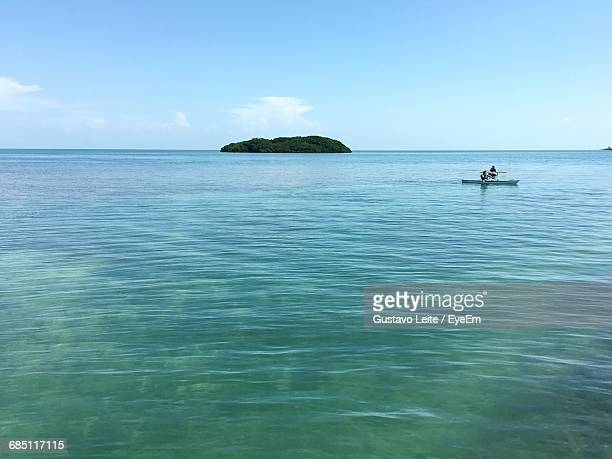 view of calm sea against blue sky - florida keys stock pictures, royalty-free photos & images