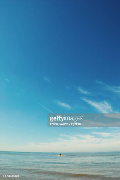 view of calm sea against blue sky - frank swertz stock photos and pictures