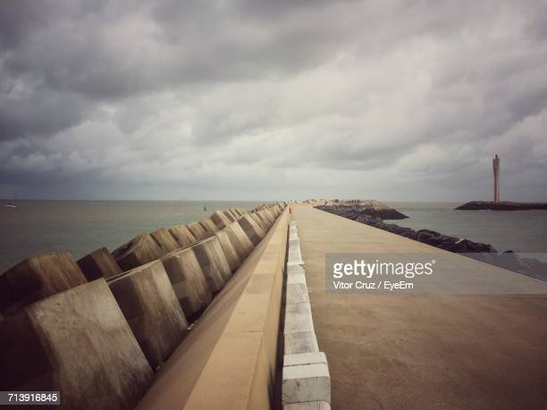 view of calm sea against cloudy sky - オステンド ストックフォトと画像