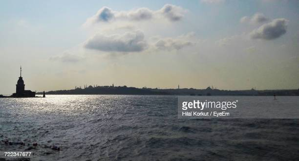 view of calm sea against cloudy sky - hilal stock photos and pictures