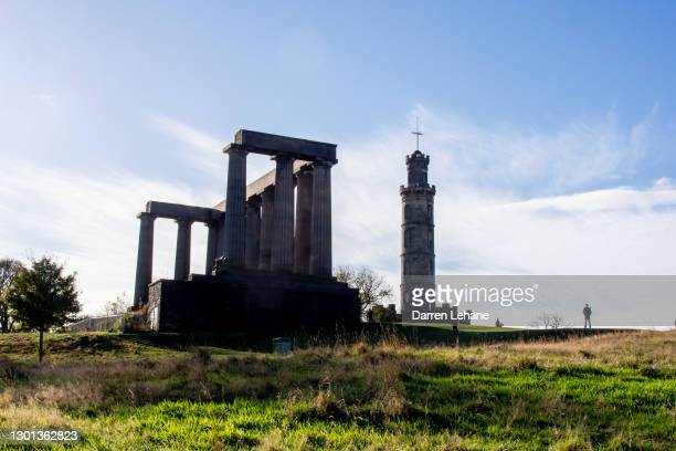 view of calton hill in edinburgh - national monument stock pictures, royalty-free photos & images