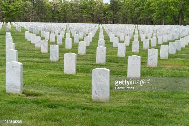 View of Calverton National Cemetery for veterans during Memorial Day weekend Veterans of all confessions Christians Jewish Muslim buried on this...