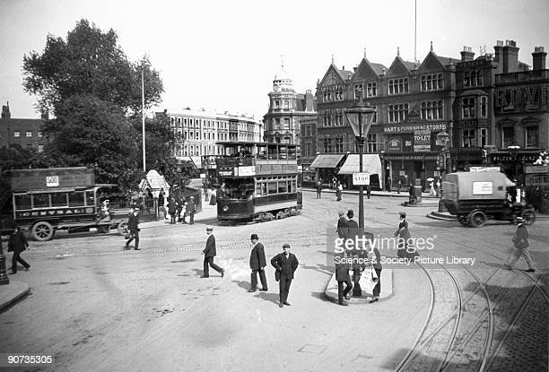 View of Camberwell Green with pedestrians trams and lorries