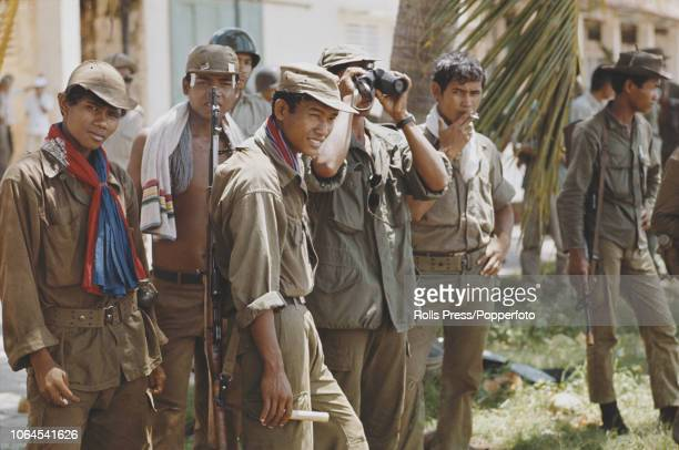 View of Cambodian Government and South Vietnam troops enjoying a cigarette break having entered the town of Tonle Bet near the Mekong River in...