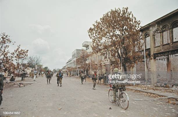 View of Cambodian Government and South Vietnam troops entering the town of Tonle Bet near the Mekong River in Cambodia after it was recaptured from...