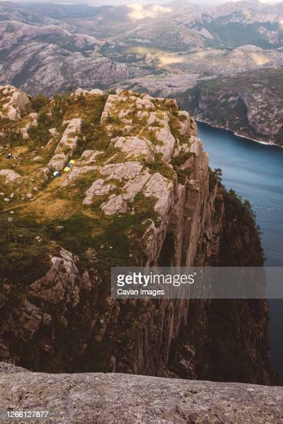 view of camping tents near edge of cliff in norway - escarpment stock pictures, royalty-free photos & images