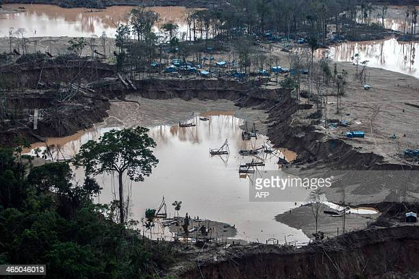 View of camps surrounding pumps used for illegal gold mining in Mega 13 Madre de Dios region Peru on January 25 during an operation AFP PHOTO /...