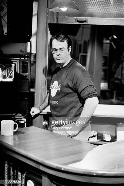 View of Canadian actor and comedian Dan Aykroyd behind a counter at MTV Studios, New York, New York, August 3, 1984.