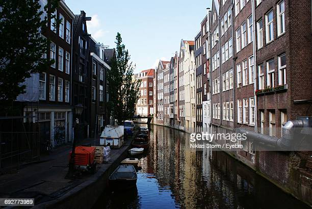 view of canal along buildings - niklas storm eyeem stock photos and pictures