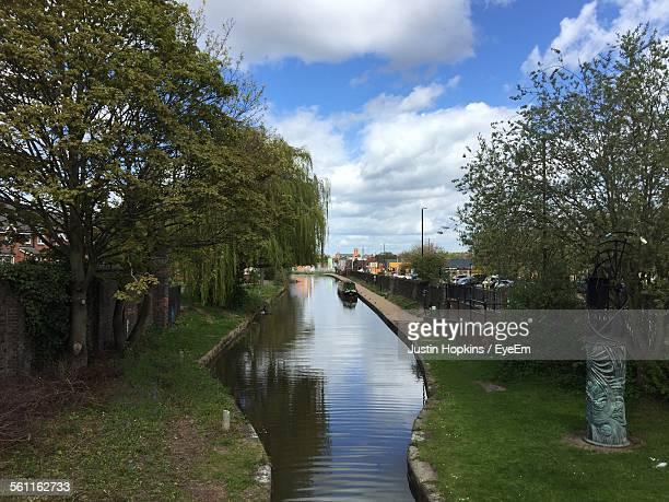 view of canal along trees - coventry stock pictures, royalty-free photos & images