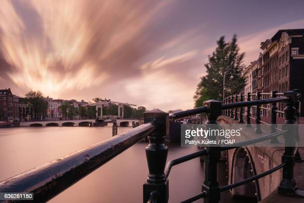 View of canal at in Amsterdam city at sunset