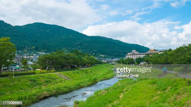view of canal in yufu city in yufuin, oita, japan - 別府市 ストックフォトと画像