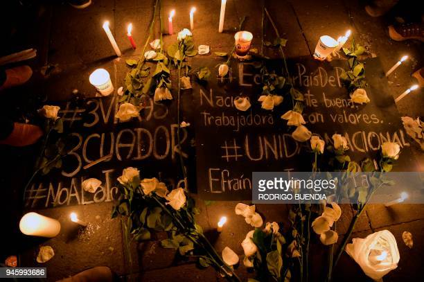 View of candles and signs during a tribute to Ecuadorean murdered journalist Javier Ortega photographer Paul Rivas and their driver Efrain Segarra in...