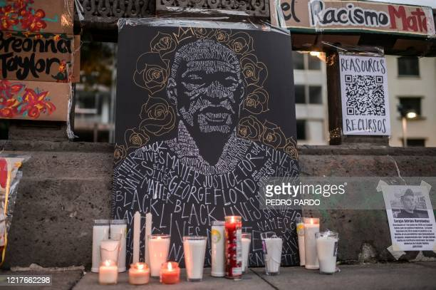 View of candles lit during a protest in front of the US embassy in Mexico City on June 4 over the death of George Floyd in police custody in...