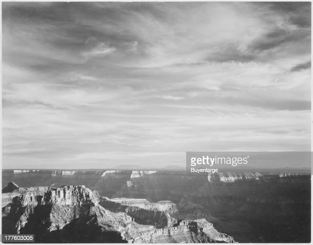 View of canyon in foreground with mountains on the horizon from the North Rim Grand Canyon National Park Arizona 1941