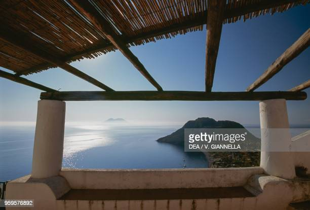 View of Capo Graziano with the island of Salina in the background from the patio of a Filicudi house Aeolian Islands Sicily Italy