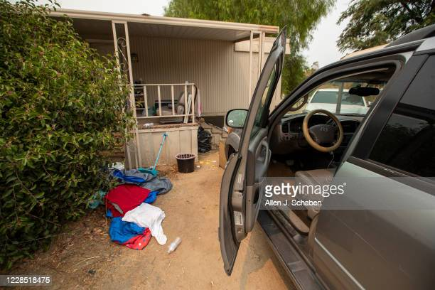 A view of car doors left open and clothing at the property where seven people were shot to death over Labor Day weekend at an illegal marijuana grow...