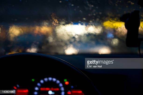 View of car from inside driving in rains
