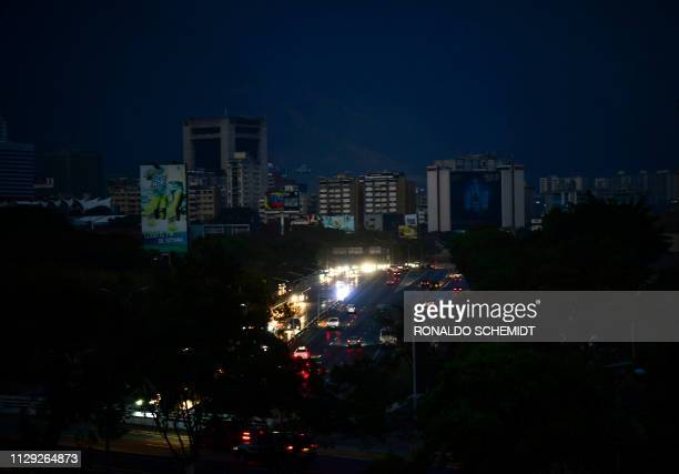 TOPSHOT View of Caracas taken on March 8 2019 during the worst power outage in Venezuela's history Venezuela was plunged into darkness on Thursday...
