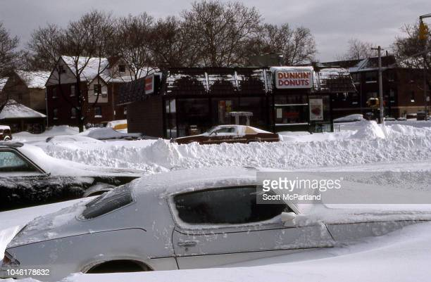 View of cars buried under snow on Woodhaven Blvd in the aftermath of a blizzard Queens New York New York February 13 1983