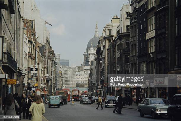 View of cars buses and traffic passing along Fleet Street in London in April 1971 Ludgate Circus and St Paul's Cathedral can be viewed in the...