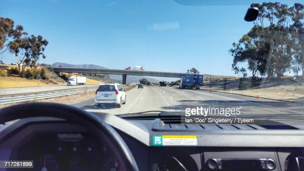 View Of Cars Moving On Road