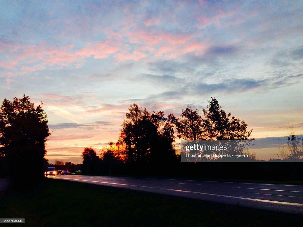 View Of Cars On Country Road At Sunset : Foto stock
