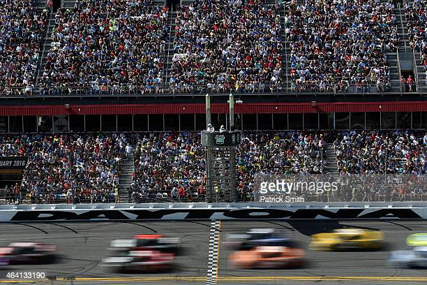 A view of cars racing during the NASCAR Sprint Cup Series 57th Annual Daytona 500 at Daytona International Speedway on February 22 2015 in Daytona...