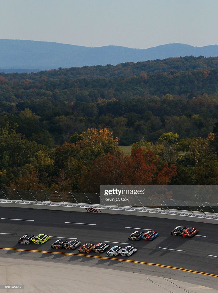 A view of cars racing during the NASCAR Sprint Cup Series Good Sam Club 500 at Talladega Superspeedway on October 23, 2011 in Talladega, Alabama.