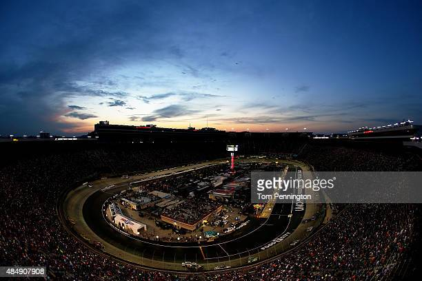 A view of cars racing during the NASCAR Sprint Cup Series IRWIN Tools Night Race at Bristol Motor Speedway on August 22 2015 in Bristol Tennessee
