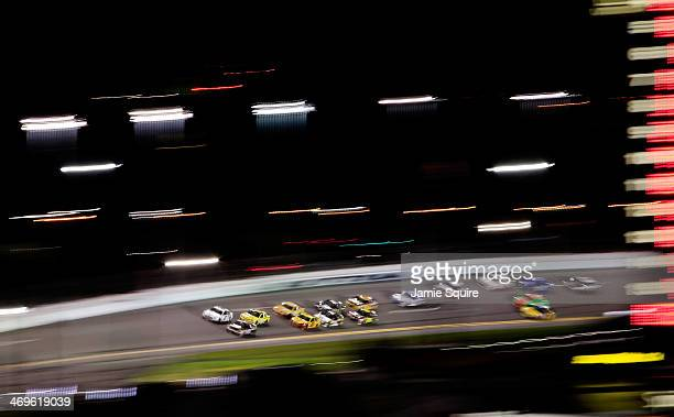A view of cars racing during the NASCAR Sprint Cup Series Sprint Unlimited at Daytona International Speedway on February 15 2014 in Daytona Beach...