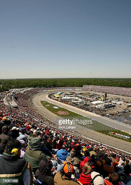 View of cars racing on the track, during the NASCAR Nextel Cup Series Jim Stewart 400 at Richmond International Raceway on May 6, 2007 in Richmond,...