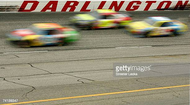 View of cars racing on the track during the NASCAR Nextel Cup Series Dodge Avenger 500 on May 13, 2007 at Darlington Raceway in Darlington, South...
