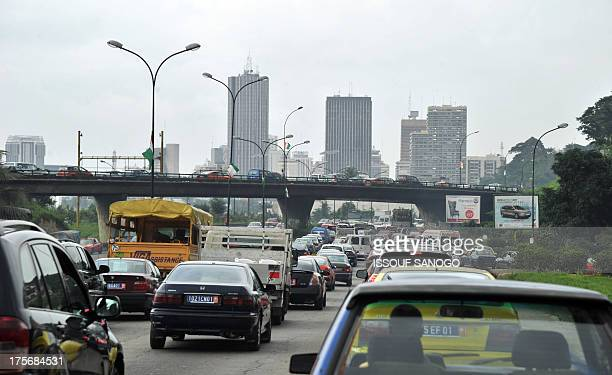 View of cars stuck in traffic on August 6 2013 as authorities started yesterday chasing street vendors after Ivory Coast's interior minister banned...