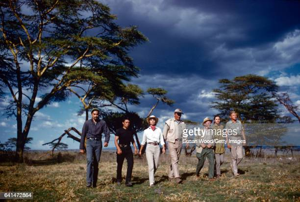 View of cast members as they walk on set during the filming of 'Hatari' Tanzania 1962 Pictured are from left American actor Valentin de Vargas French...
